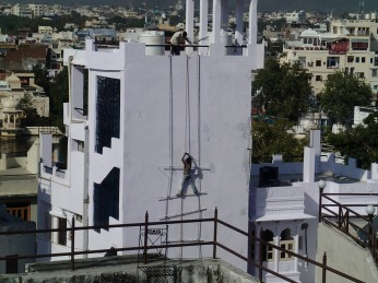 Bonus photo: Some dude hanging off a building to paint it, because fuck you, heath and safety.